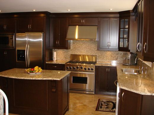 Love the dark wood cabinets light granite countertop and stainless steel appliances kitchen L shaped kitchen design for small kitchens