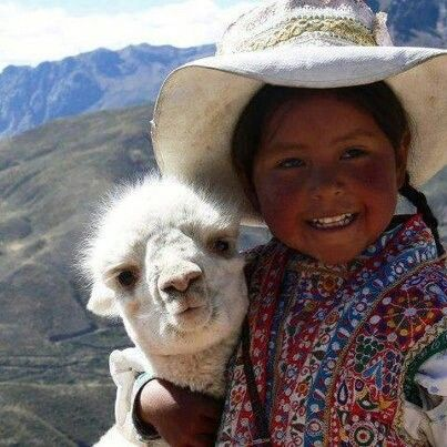 We <3 this image of a girl hugging a Llama! Arequipa, Perú.