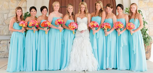 hate to admit it but I just adore wedding photography. This bride's dress is gorgeous and I'm loving the light blue for the bridesmaids