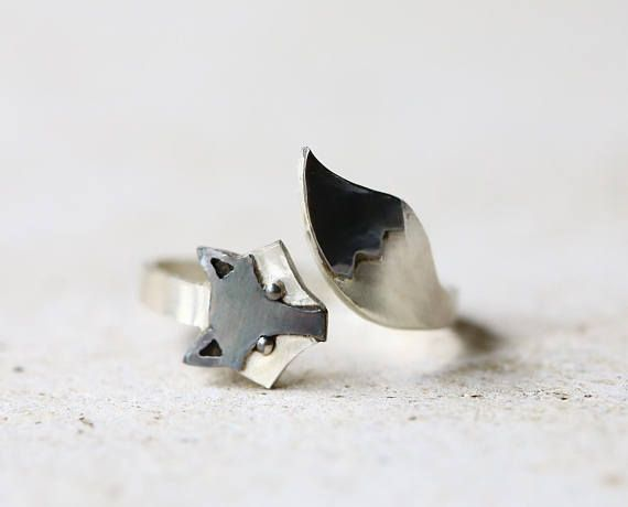 A totally handmade sterling silver fox ring. This adjustable ring has a fun style inspired by nature