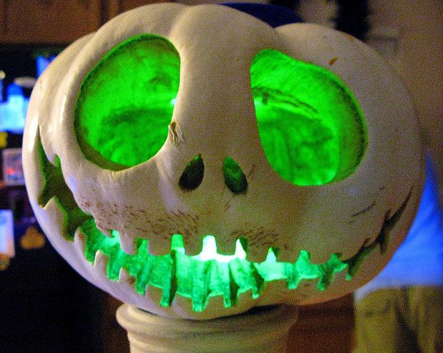 Jack the pumpkin king pumpkin.  Carve your white pumpkin to look like Jack. Add a green glow candle.
