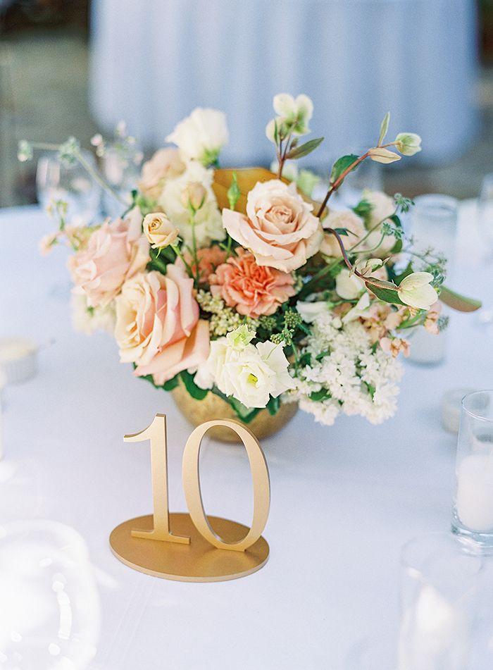 Peach, Nude, and Coral Flower Arrangement with Gold Table Numbers  https://heyweddinglady.com/bridal-glam-meets-organic-florals-italian-inspired-wedding/      #wedding #weddings #weddinginspiration #fineartphotography #realwedding #brides #glamwedding #glam #galialahav #filmphotography #weddingday