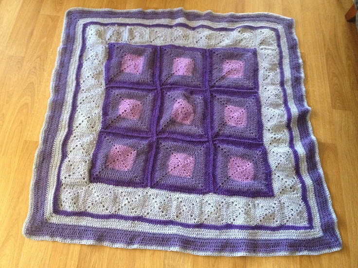 Crochet rug in different shades of purple