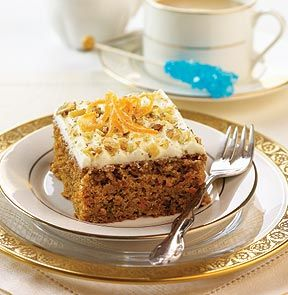 "HOMESTYLE CARROT CAKE. The best way to eat your carrots. This classic cake is made with fresh shredded carrots, plump raisins and a special blend of spices, then topped with walnuts and a thick pineapple buttercream icing. 5"" x 12"" tray. - M & M Meat Shops"