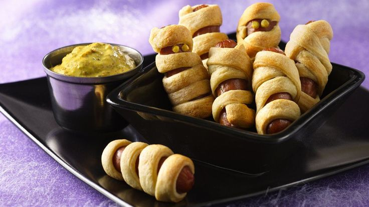 Halloweenies with Mustard Dip recipe and reviews - Wrap up snacks with these smoked mini-sausage treats, wound up in strips of refrigerated flaky dough.