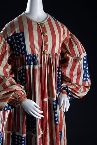 """""""American Flag"""" costume - Printed cotton, metal buttons - Circa 1889,  USA. Costumes were commonly worn to parades and pageants during the 19th century and were intended to promote national identity and  patriotism. The flags on this costume contain 39 stars, most likely in  anticipation of the Dakota Territory attaining statehood, but the  territory was split into two states."""