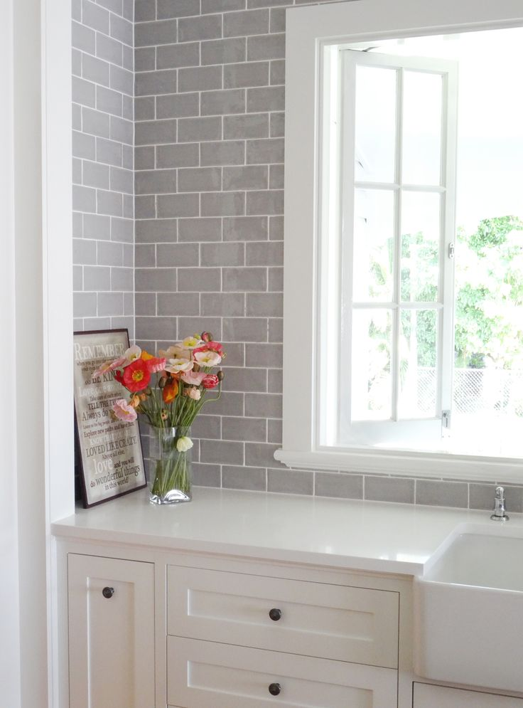 This colour grey subway tile with white grout to tie in with pendants?