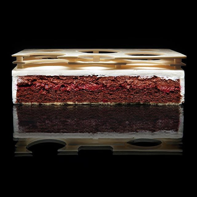 """Cake """"Cherry""""   crunchy almond base, chocolate biscuit  with cocoa and chocolate, cherry coulis, chocolate cream with cherries, cream with mascarpone, chocolate decor."""