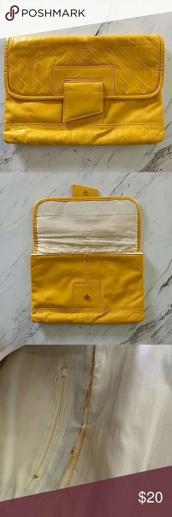 """Vintage Mustard Yellow Leather Clutch Purse SO CUTE. Unsure of brand. So soft! It does say """"genuine leather"""" on the tag (see photo.) Size is 8""""x12"""" this is the perfect accent to your fall wardrobe! Tiny pen mark, cannot see very well at all! Have not tried to remove. See photos for interior condition. There are stains, but that's true of most vintage purses I've seen!  Does not affect exterior at all. Bags Clutches & Wristlets"""