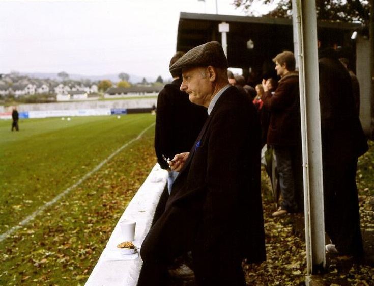 An old man and his half-eaten pie at Kendal Town in 2007. Photographer unknown.