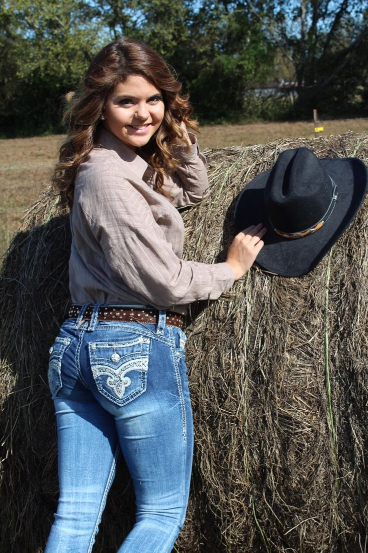 Cowgirl pictures on a hay bail.