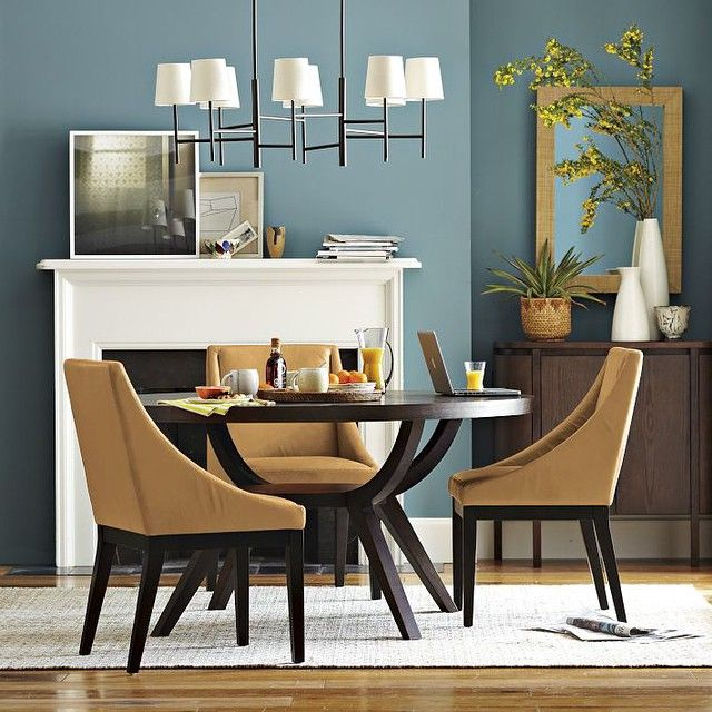 Round tables help maximize space in any dining area! This room features our Arc Base Pedestal Table. #westelm #styletip