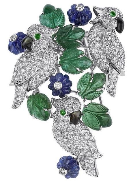 Cartier Naturellement collection brooch with diamond and onyx parrots, carved emerald leaves and sapphire flowers.