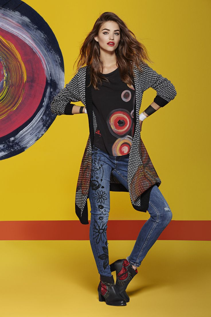 Thick knitted warm cardigan with a black and white print, a splash of color and lots of good vibes.