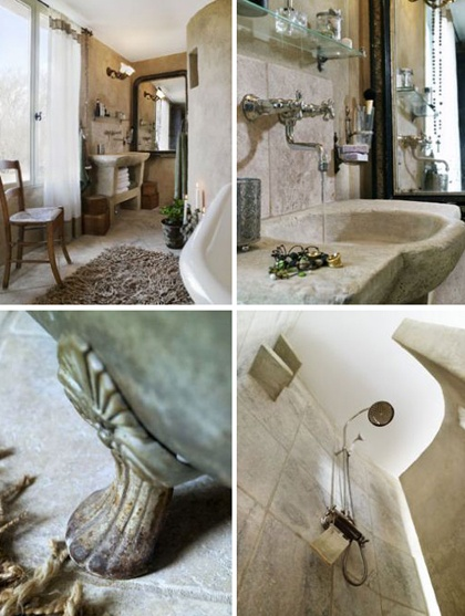 Earth tones, natural materials and rustic fixtures are combined beautifully in this rural, French inspired bathroom. Check the stone carved basin, the vintage footed bathtub and the smart way the toilet is hidden behind the curved wall.