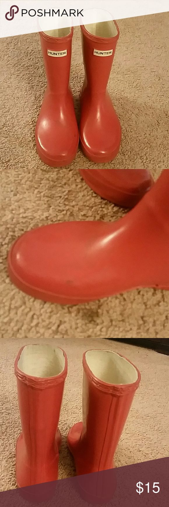 Unisex Kids Hunter Rain Boots Red Hunter Boots. Does have some wear on the bottom of the sole near the back of the heel as seen in pics. Some scuffs on the boot as in pics also. My daughter wrote them for a good winter. Lower price because of the wear on the heel so now is a steal. Hunter Boots Shoes Rain & Snow Boots