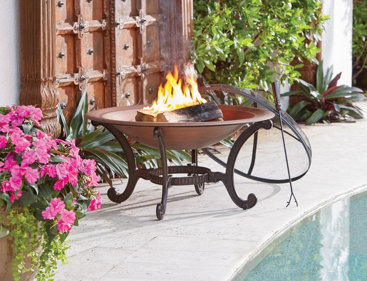 Perfect For Any Summer Night, The Aria Wood Burning Firepit Features  Durable Steel Construction With