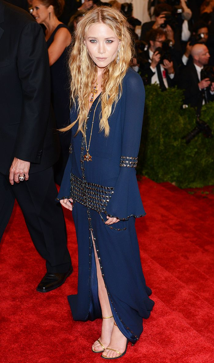 Mary-Kate Olsen wearing an embellished navy gown and gold ankle strap heels