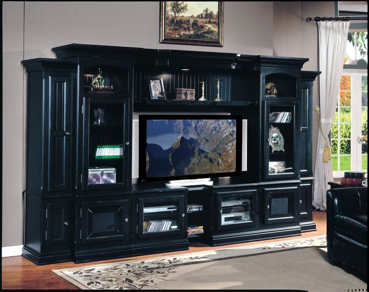 I would put my Google tv on this entertainment center. I love all the shelves and places to put movies and figurines.