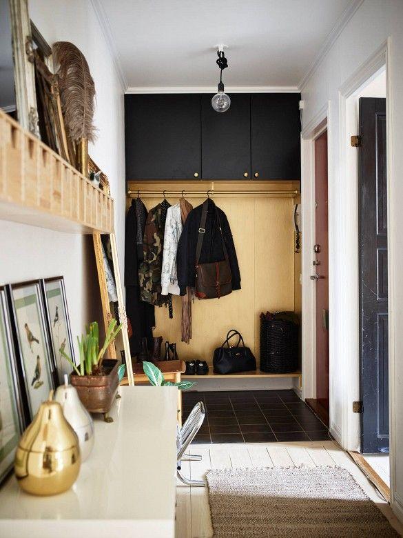 Entryway turned mudroom in light wood space