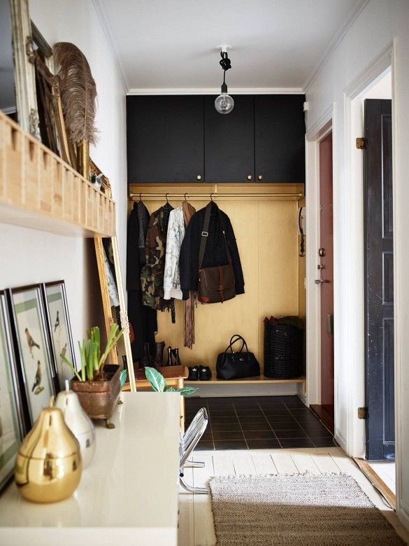 Entryway turned mudroom in light wood space