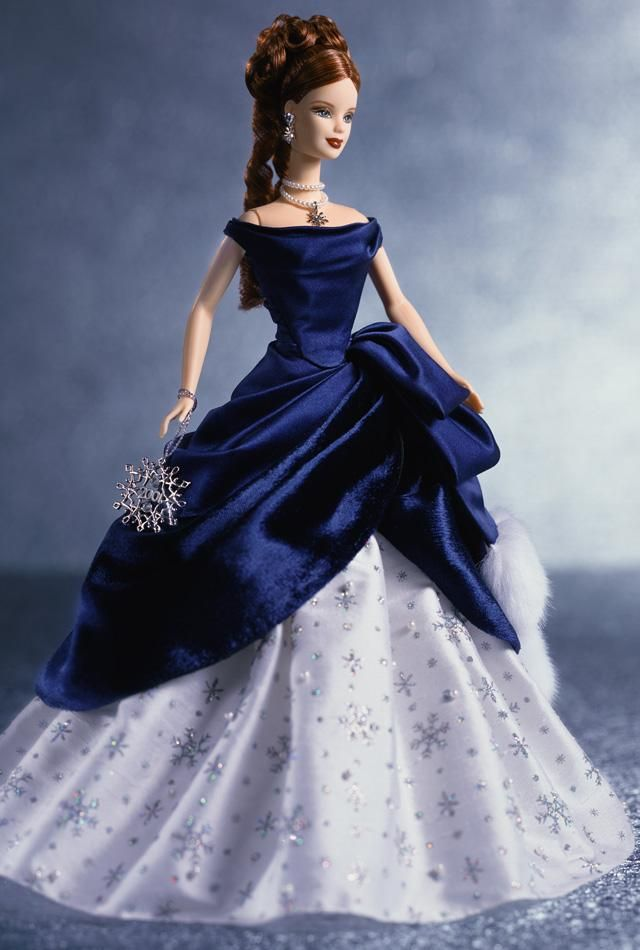 I don't typically like the holiday collections, but I do like this one.....Holiday Treasures™ Barbie® Doll 2001 | Barbie Collector    Love the Holiday Barbies!! And the little ornaments of them too!!