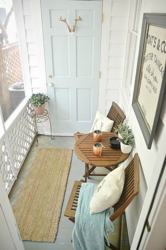 Small porch with rustic furniture