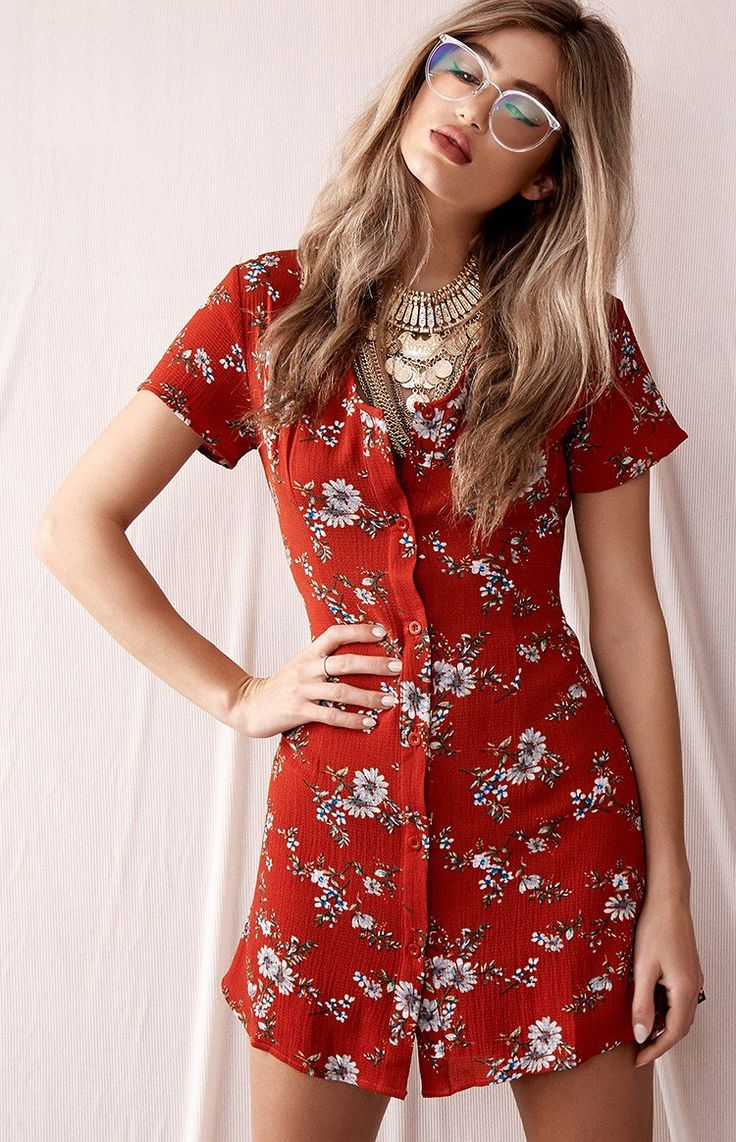 Sunday sessions will never be the same again, now the Head In The Clouds Dress Red Floral has arrived to get the party started! Made from a red crepe fabric, adorned in a blue and green floral print, this lined Summer dress features a button-down front, a slightly v-neckline and a waist tie. What could be better than a rooftop party in the sunshine with your best girlfriends and the Head In The Clouds Dress Red Floral?! Not much! Just add heels and aviators for a  pretty daytime look…