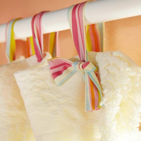 Spring Curtain Decor            Give the window curtains a little springtime sprucing by replacing curtain hooks with colorful ribbons. Be sure to tie the loops loosely enough to allow for easy sliding.