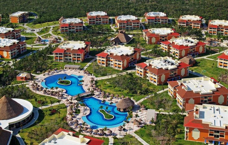 The Grand Bahia Principe Coba winds through a tropical paradise of lush jungle that leads to a white sandy beach and turquoise water.