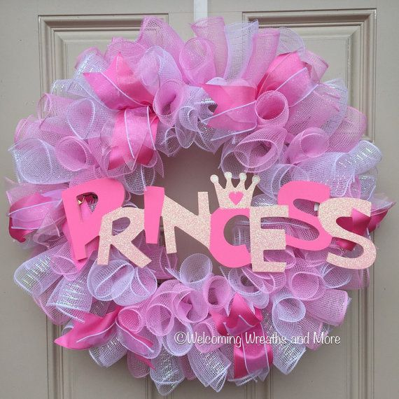 This adorable Princess wreath would look lovely in any little girls room!  This girly wreath measures 24 in diameter and is constructed out of metallic white and pastel pink deco mesh. It is accented with sheer white wired ribbon and pink wired ribbon. The centerpiece is a glittery wood sign that reads, Princess. This would be perfect for a Princess themed little girls room, a baby shower, or even a wreath to hang on a hospital door!  Free shipping!  Check out our other wreaths here…