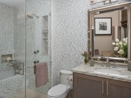 From changing the paint color to knocking down walls, see how your favorite HGTV hosts take on these tiny bathrooms.