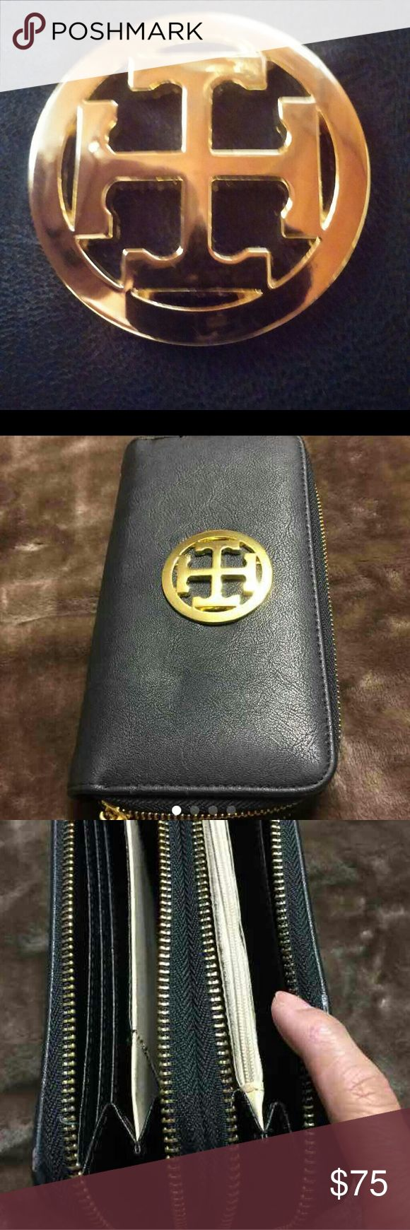 BLACK LEATHER WALLET I bought this and seen it's a Tory Burch REPLICA. In spite of that, this wallet is LIKE NEW, and very beautiful as well.  Black Leather. Very spacious. It has 2 separate zipped compartments. 12 card slots,  a zippered pouch for change.  4 slots for bills or whatever you wish to carry.  Could definitely hold a phone.  Has an eyelet for a strap,  but one isn't included. Could be taken to a shoe repair or leather shop and attach a strap for cheap.  I'm just looking to…