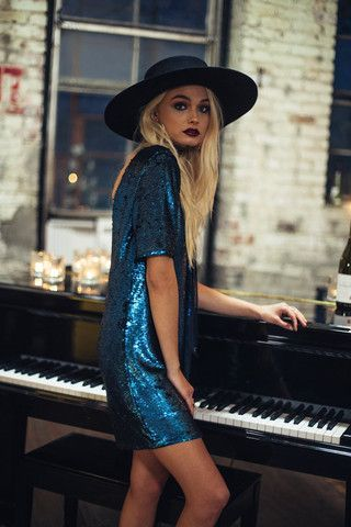 Relaxed fit matte sequin dress. Short sleeves. Low back. Fully lined. Style #: ID6356C Material: Polyester/Rayon Color: Blue Model is wearing a small