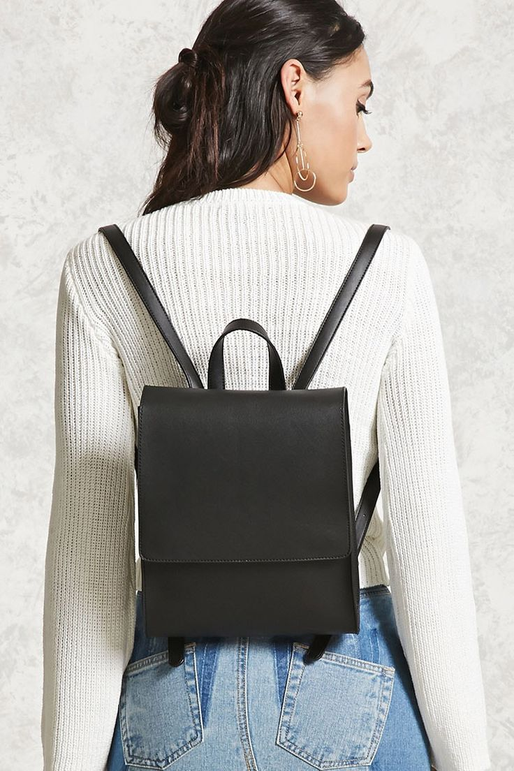A structured faux leather backpack featuring a flap-top with magnetic closures, top handle, and adjustable buckle shoulder straps.