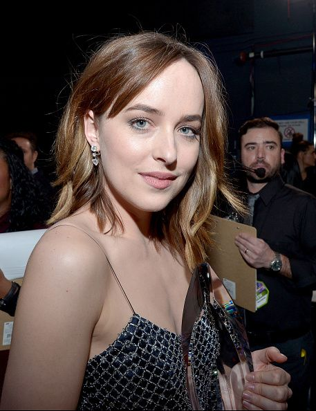 Actress Dakota Johnson winner of the Favorite Dramatic Movie Actress award attends the People's Choice Awards 2016 at Microsoft Theater on January 6...