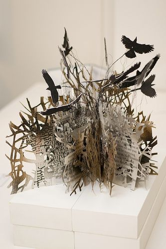 3D cut paper art made from a book Sarah Morpeth has made herself.  Found on a British (I believe) site called Domesticali. Interesting discussion by artists about the deconstructing of books to create visual art, passionate pros and cons.