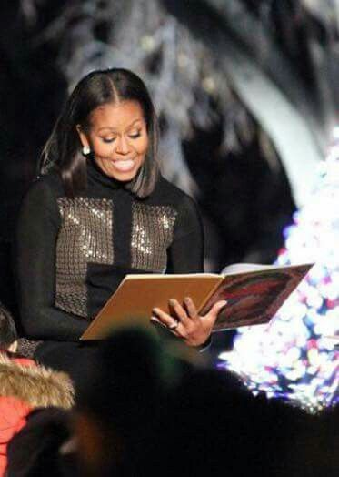 First Lady, Michelle Obama reading a Christmas story.