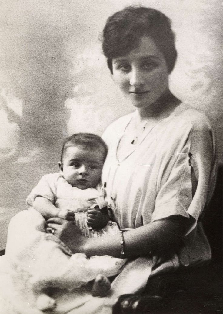 This is, I believe, Zizi Lambrino, 1st wife of King Carol II of Romania, with the couple's son, Mircea.  Mircea was born after his parents' marriage was annulled, making him illegitimate.  However, the legality of the annulment has been questioned and Mircea was recognized by courts in Portugal, France, and Romania as Carol's legitimate son, although he laid claim only to some of Carol's property in France and Portugal, never to the Romanian throne.