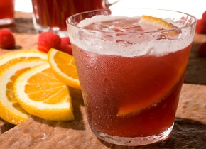 Lambic Sangria- 1 (750-milliliter) bottle Framboise lambic, such as Lindemans, 2 (11.2-ounce) bottles Hoegaarden white ale, 6 ounces Lillet Blanc, 6 ounces raspberries (about 1 cup), 1/2 medium orange, thinly sliced
