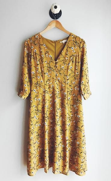 Beautiful floral print midi dress in a beautiful mustard color. Has pretty button up detailing on the bodice.  100% Polyester Handwash