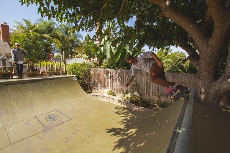 mini skate ramp in backyard.