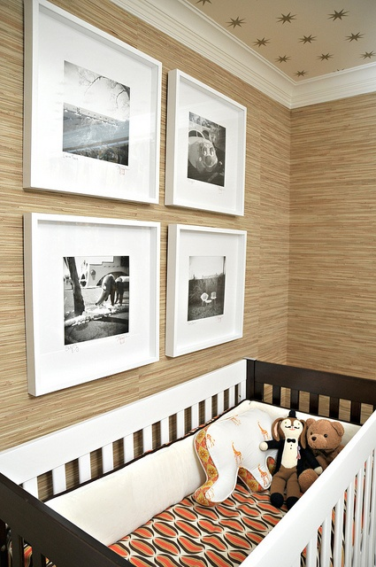 nursery with grasscloth wallpaper (and star wallpaper on the ceiling)
