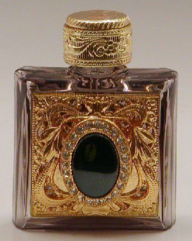 Mouth-blown glass perfume bottle handmade in the Czech Republic by a 200-year-old family-run business.