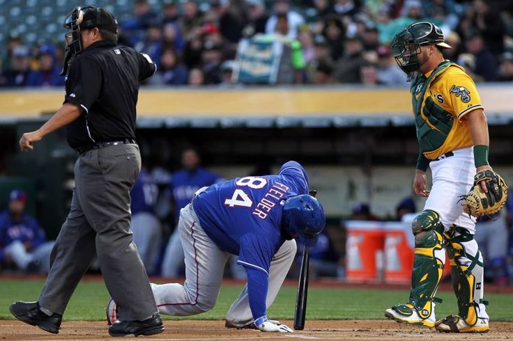 Apr 7, 2015; Oakland, CA, USA; Texas Rangers first baseman Prince Fielder (84) gets up after being hit by a pitch thrown by Oakland Athletics starting pitcher Jesse Hahn (32) )not pitchered) in the first inning of their MLB baseball game at O.co Coliseum. Mandatory Credit: Lance Iversen-USA TODAY Sports