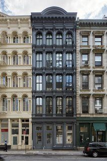 """A Hidden Penthouse Sits Atop a Historic Cast-Iron Building in New York - Photo 3 of 16 - Earning the nickname """"The Obsidian Building,"""" the charcoal gray facade conceals the penthouse and modern renovations from the street level."""