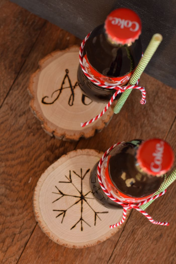 DIY Wood Burned Coasters make cute personalized handmade gifts for Christmas or other gift giving. See the full craft tutorial and idea. AD #DeliverTheJoy