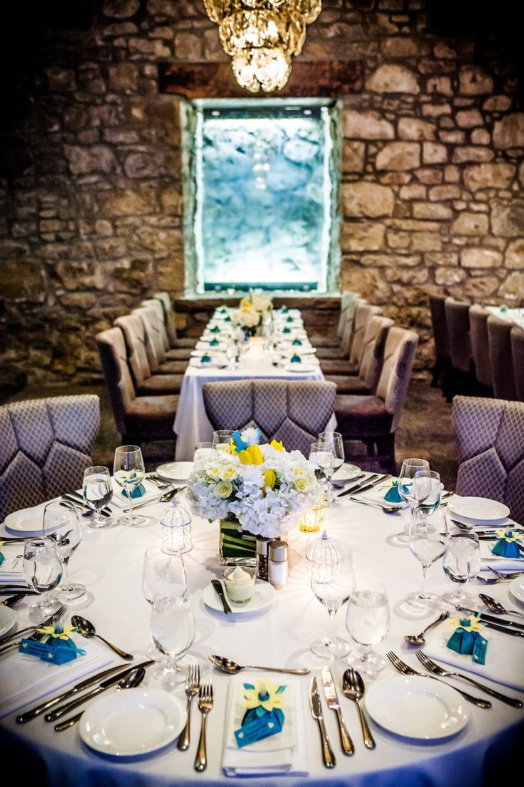 Yellow, blue and white, Table setting, Floral centrepiece, Wedding table, Stone wall, Elegant, Chandelier, Cambridge mill, Cambridge, Ontario, Canada wedding photography experts | Anne Edgar Photography