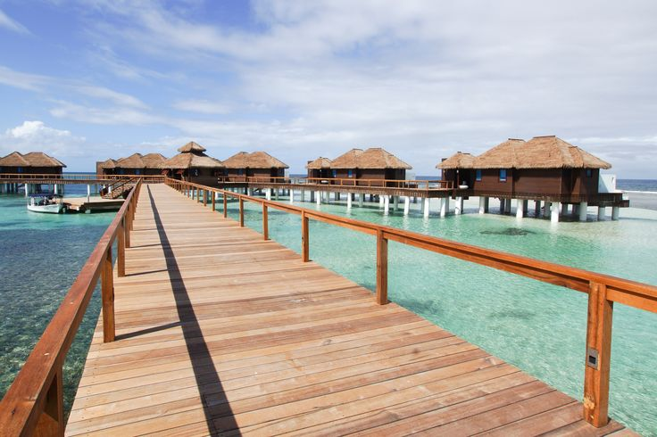 The Caribbean's First Overwater Bungalows Are Here—After 50 Years in the Making