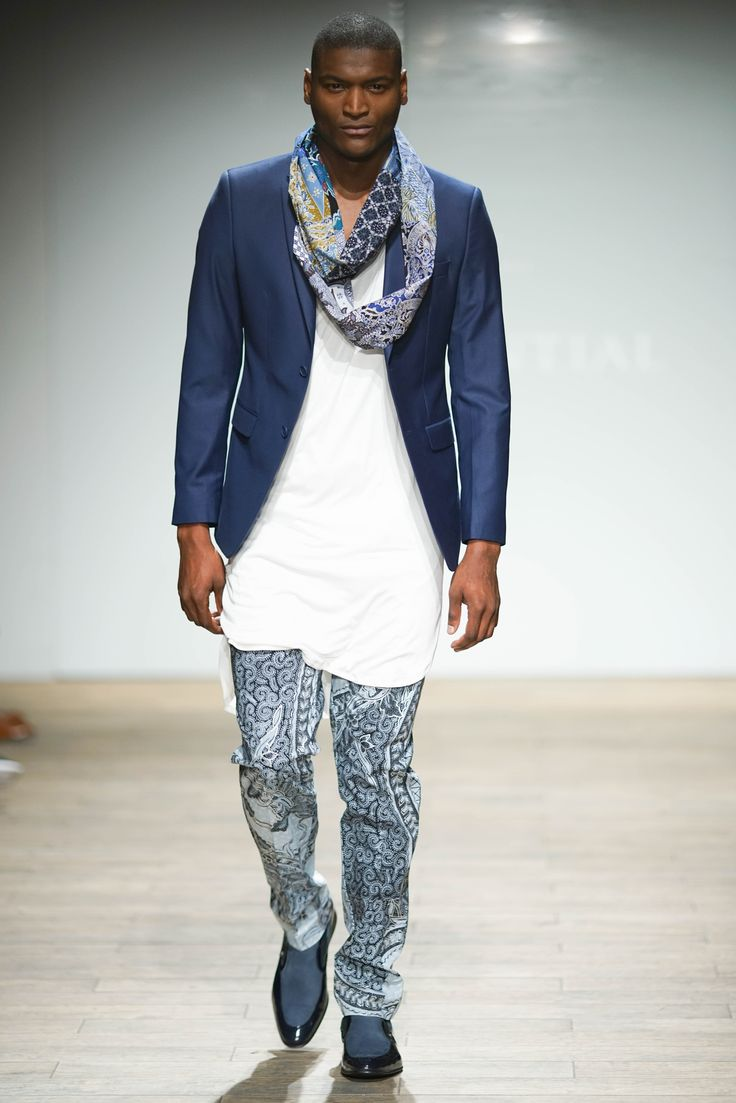 Wool blend blazer worn with a long wrap V-neck cotton top and hand-batik fabric pants complemented with a patch designed eternity scarf. #SAFW #SAFWmen #SAFAW17 #PresidentialSAFW #AfricanHauteCouture #HeritageMonth #MadInSA